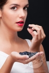 Close-up of woman eating blueberries